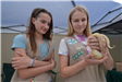 Girl Scouts holding reptiles